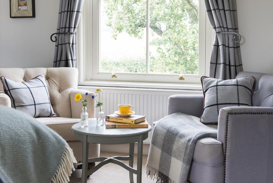 Comfortable arm chairs by the window in bedroom 1 | Croft ...